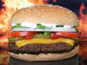 Dieters who fall off the weight loss wagon love to reward themselves with greasy hamburgers.